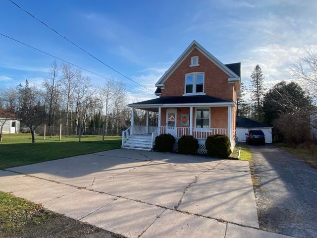 Historic brick home built in the 1800's! This 3 bedroom, 2 bath home is in nice condition. Home has a full basement and a 2 car detached garage.