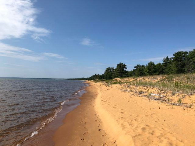 Glorious untouched frontage on Whitefish Bay 7 miles north of Paradise