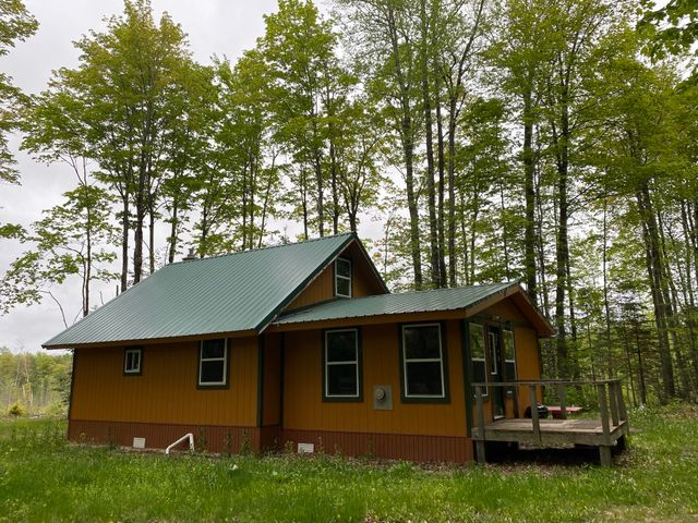 40 acre camp. Drilled well, off-grid, propane/generator.