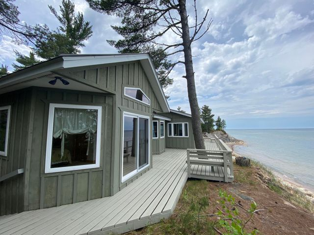 Spectacular views from this stunning cabin on 235 feet of Lake Superior frontage