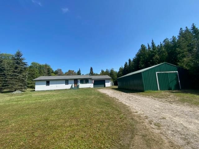 located just off the main M-134 down a gravel private maintained road - Is this Year round Detour home, wooded 1 acre lot, walking distance to the water - 2 miles from the state campground - excellent home - or investment for a rental