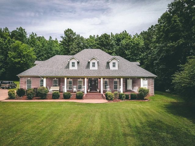5 Bedrooms, 4.5 Bathrooms, Office, Formal Dining Room, Large Laundry Room with Safe Room and Bathroom with Shower, Powder Room in Foyer on Main Level, Custom Kitchen, Large Study/Sitting Area upstairs, Upstairs Den, 2 Full Bathrooms & 4 Bedrooms also upstairs.