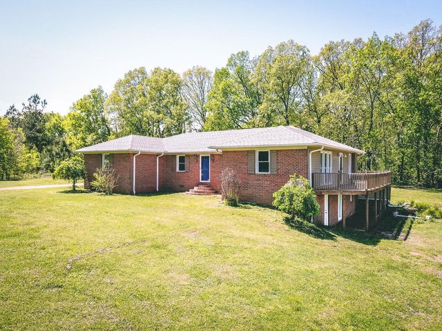 3+ Bedroom, 3 Bath, Bonus area downstairs with back yard access plus 4+/- acres with a large pond
