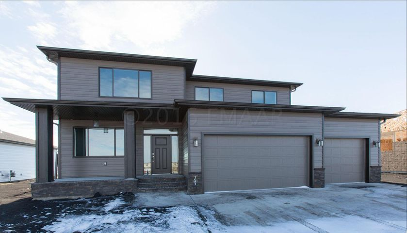 Front Elevation Showing Over Sized 3 Stall Garage that Includes Floor Drain & Gas Heater Rough-In!