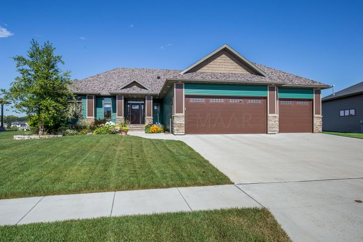 Great curb appeal with seamless steel siding, stone accents and extensive landscaping!