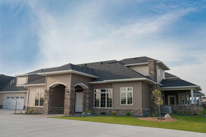 Beautiful Exterior with stone and seamless steel siding.
