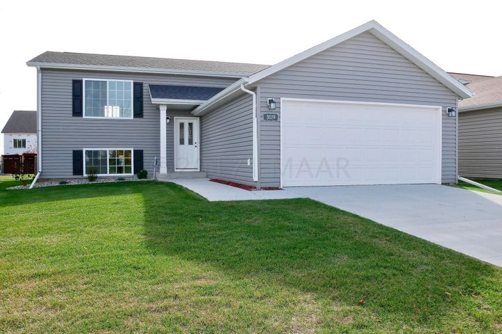 4bedrooms and 3 bathrooms, an open kitchen/living/dining gathering space and yard and landscaping are complete!