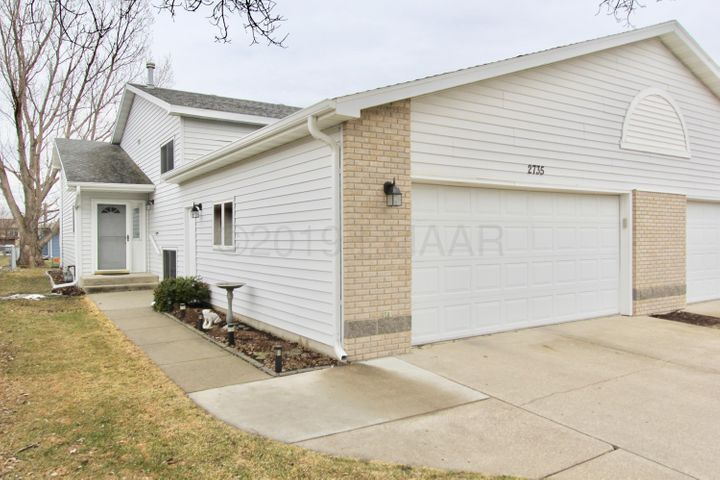 beautifully landscaped, large double stall garage