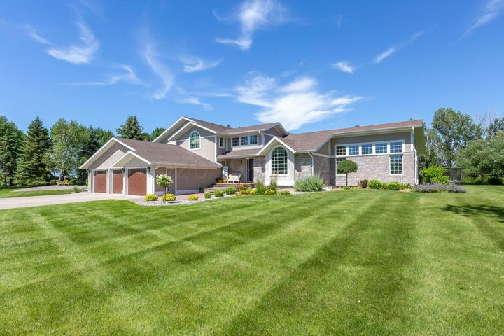 Gorgeous modified 2 Story on a 2.76 acre beautifully manicured lot.