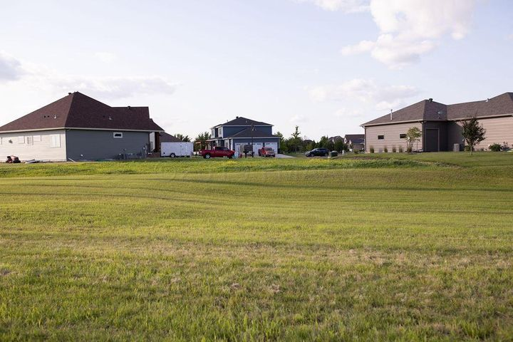 Looking towards cul-de-sac lot from City of Fargo Green space behind the lot.
