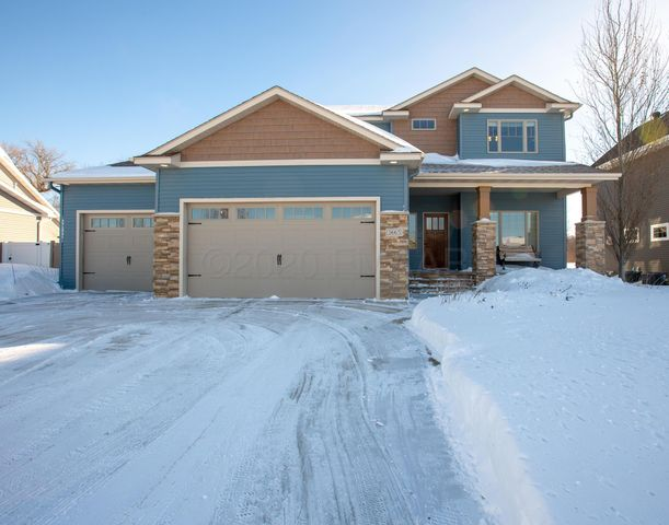 Custom built 2 Story with maintenance free siding and covered front porch.