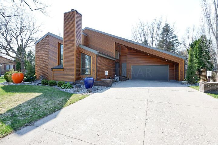 New cedar siding on this stunning home located in a quiet North Fargo neighborhood