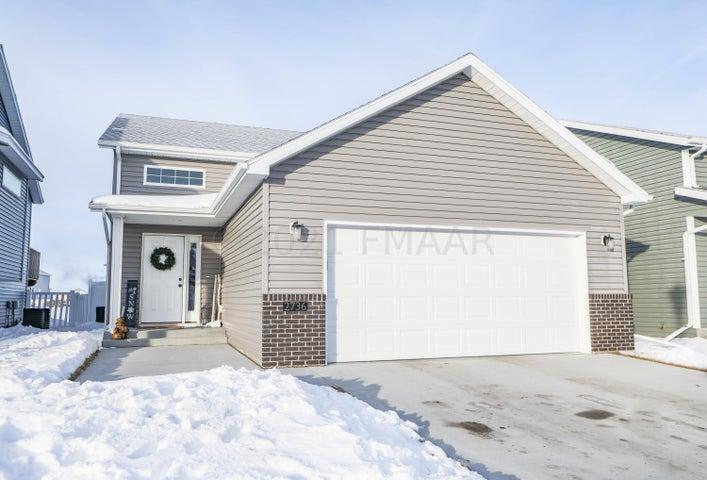 Attached garage features insulation, sheetrock, & floor drain!
