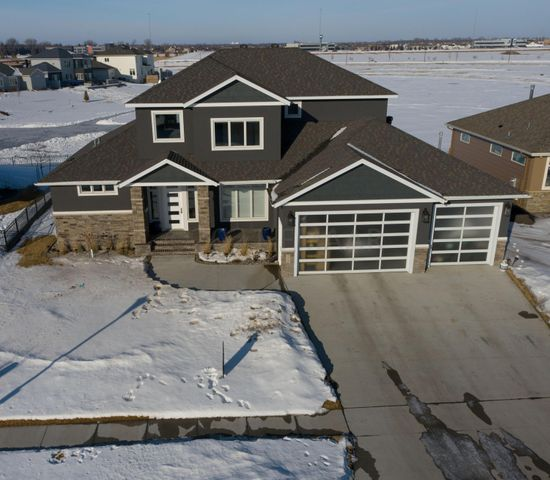 Welcome Home to 2515 N Pond Drive E in West Fargo!