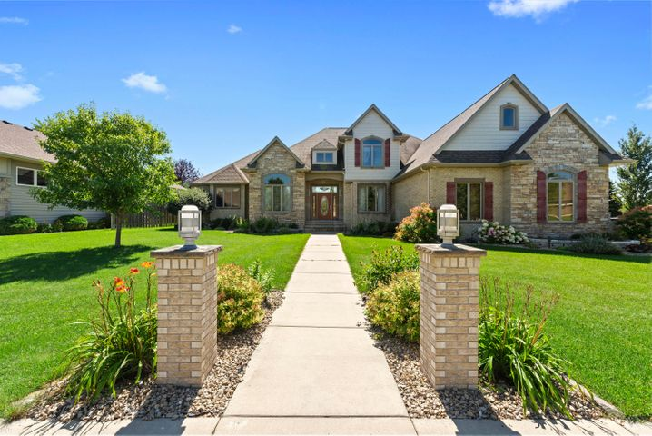 Stately walk up to the covered front entrance and welcoming foyer.