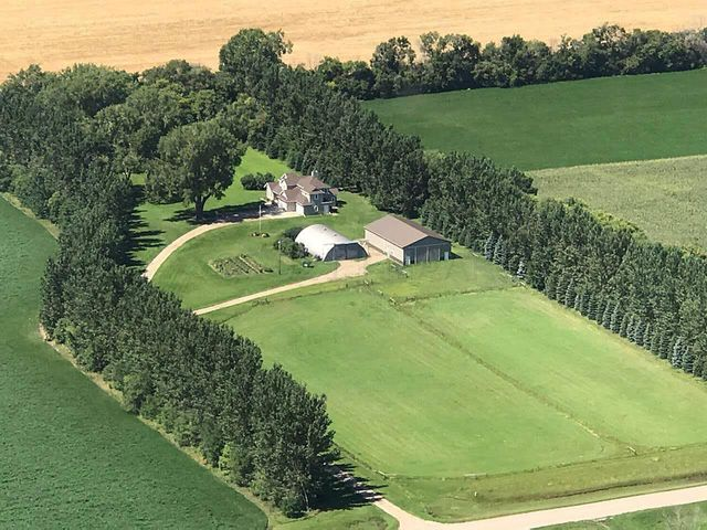 11.15 acre farmstead with large 2-story home built in 2004. Perfect for horses.