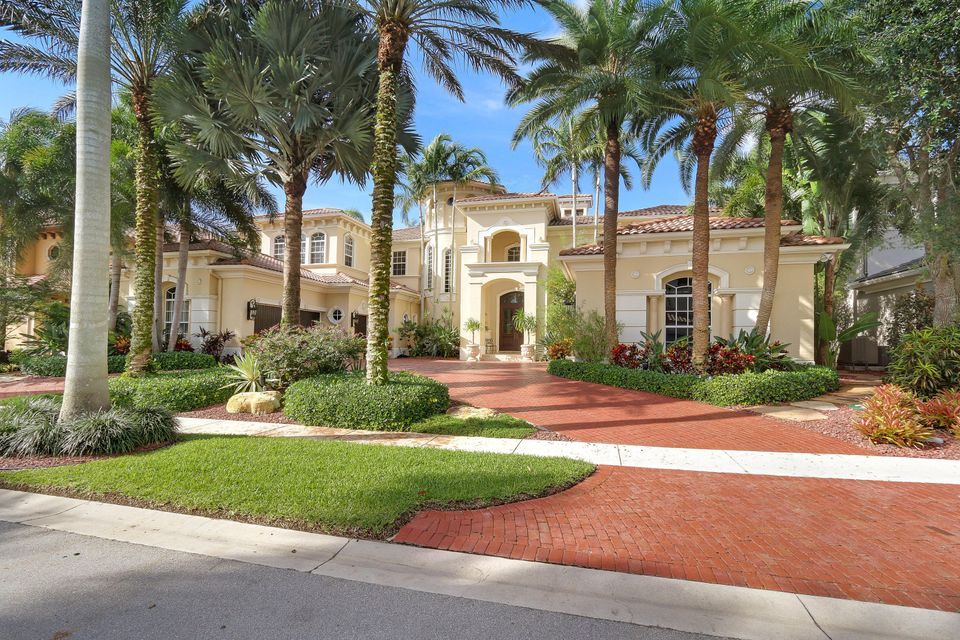 OWNER WANTS AN OFFER TODAY!!A stately impression is offered by this magnificent Mediterranean-inspired estate in prestigious Mizner Country Club. Spread over 7,600 square feet of living space, there are 6 oversized bedrooms plus a spectacular wood paneled office with game loft and 7 and 1 half bathrooms - making space abundant and airy. The dramatic double-door entry gives way to the soaring ceilings of the main areas which are accented by a custom fireplace and large windows. Upgrades include a gourmet kitchen with rich wood cabinetry, granite countertops, and upgraded appliances, custom built-ins, beautiful marble and wood flooring that adds to the expansive feel, sweeping views of the lake and golf course, 3.5 car garage, a media room, and tremendous master suite. which features its own private sitting area, separate walk-in closets, a luxurious master bathroom with fine countertops and appointments, and much more. The exterior of the home features an outdoor kitchen and expansive lanai, and a spectacular custom-designed retreat pool which is complete with a spa and statue, and surrounded by lush tropical landscaping. This is a true masterpiece, and can be viewed by appointment only.