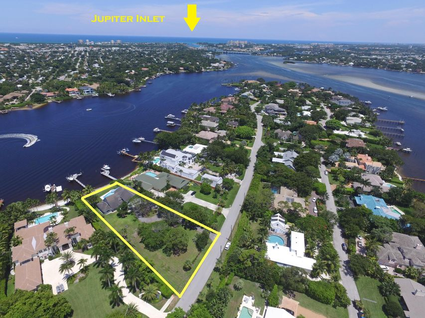 This incredible Anchorage Point property has not been available for over 20 years. Situated on Tequesta's finest stretch of riverfront, this lot is nearly one acre in size and boasts 107 feet of frontage on the Loxahatchee River. 18996 Point Dr offers wide, Eastern views and a private dock with boat lift. With no fixed bridges and direct ocean/Intracoastal access, this is a boater's dream. Located on a peninsula, this neighborhood sees very light traffic. Surrounded by some of Florida's finest golf courses and beaches, Tequesta offers a little something for everyone. This property is a unique opportunity to build your dream home on the wild and scenic Loxahatchee!