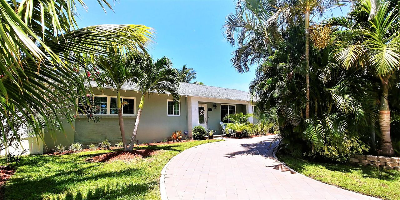 Welcome to paradise! This completely renovated 5 bedroom 2.5 bath pool home will amaze you. Brand new kitchen with custom cabinets, granite counter-tops, impact door & windows. With remodeled pool house bathroom and fresh interior paint. This is one of the only properties in North Palm Beach with an In-law suite overlooking the beautiful pool and backyard oasis. BRING YOUR FUSSIEST CLIENTS, THEY WILL LOVE THIS PICTURE-PERFECT HOME.