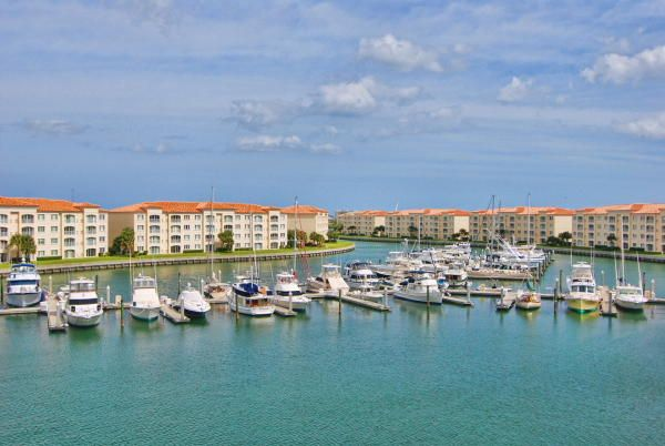 Wake up to the BEST VIEWS of the Marina from your beautifully decorated Florida Room.  Breathtaking sunrises greet you in your completely furnished --all you need to bring is your tooth brushes--Penthouse condo. Upgraded beyond belief including beautiful chandeliers, 9.5'' crown molding, wainscoting with wood panels, custom light fixtures, custom window treatments and plantation shutters. You have the inlet view from the front door and marina view from the back of the condo.  Gated waterfront community with resort amenities and 24 hr manned security.  Pets and pickup trucks welcome.  Walking or biking to restaurants, fishing, beaches, and shops. This is a decorator's dream to call home!!