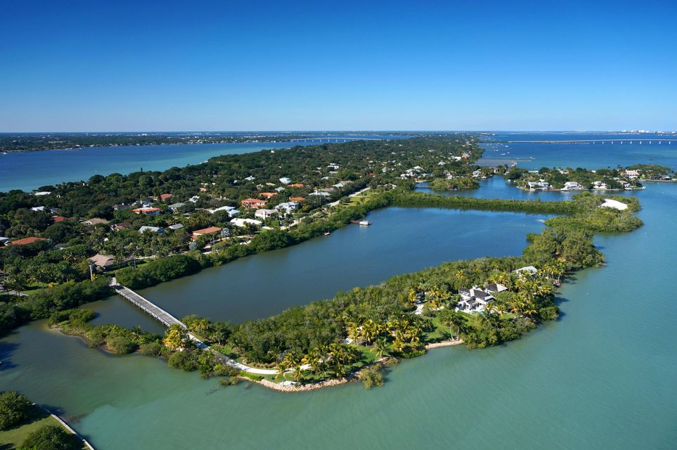 Memories are made here! A tropical oasis with tranquil blue waters, sandy white beaches, swaying palms and perfect southeastern exposure paints a picture of the island lifestyle. Once in a lifetime does an uber-property like this come on the market! Accessed by a private bridge with 2,700+/- ft. of shoreline surrounding the 3.4+/- acre island plus an add'l 10+/- acres of submerged land allowing forultimate privacy and endless water fun. This unique property offers two seaside cottages, designed by renowned architect, Peter Jefferson. The island offers for plenty of room to host family and friends in a tranquil, laid back atmosphere without leaving the urban benefits of shopping & dining. Deep water with ocean access,close to executive airport. Own your own island right here in Stuart, FL