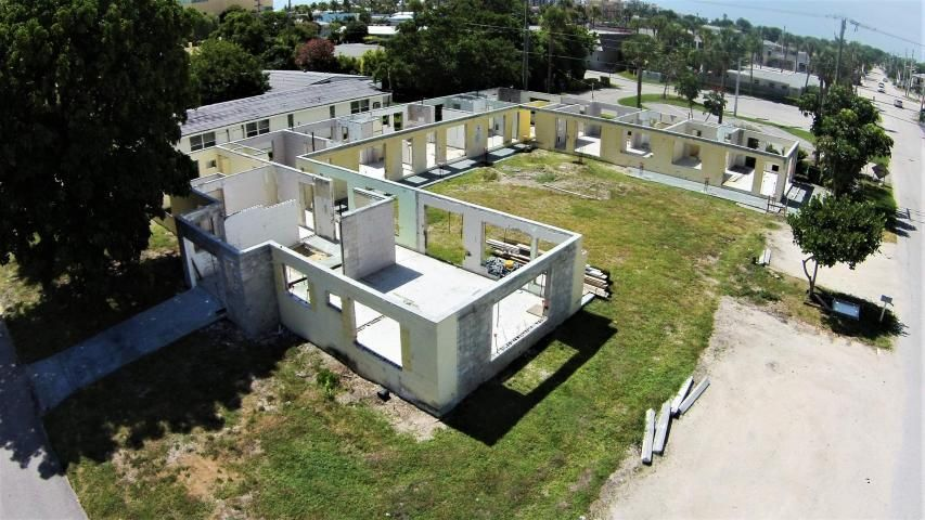Building opportunity to create your own six-plex across the street from the Atlantic Ocean.