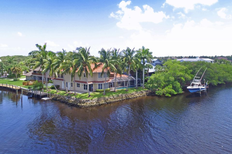 Capture the wild & scenic Loxahatchee River from every room of this 4BR/3.5BA, CBS home.  With approximately 200 ft. of water frontage, there is protected dockage, unobstructed views, no fixed bridges and large tackle room. Interior features include: wood floors; spiral staircase; screened pool & lanai; and, loft for prime office space. Just a short cart ride to Tequesta Country Club and Turtle Creek Country Club. Priced aggressively for a fast sale!