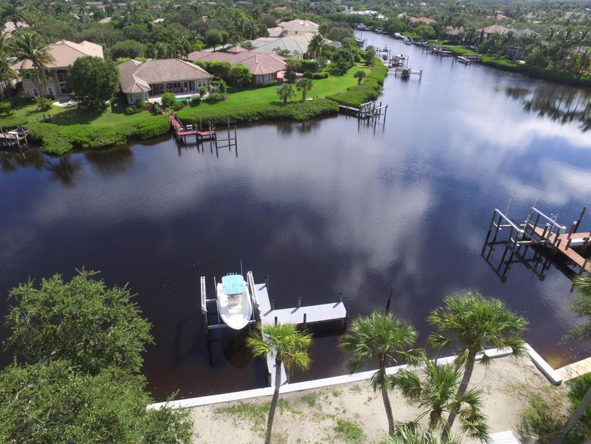 RARE 1/2 + with NEW 100' Seawall.  Deep Water. NO MANGROVES! NEW DOCK and LIFT.  Wide and long water views. Ocean Access with One fixed bridge with clearance of 15-18' depending on tide. NO Home Owners Association! Renovate this CBS Home with Roof 2013 or BUILD DREAM HOME on this amazing estate property nestled among multi million $ homes.  Large Oak Trees have been removed.