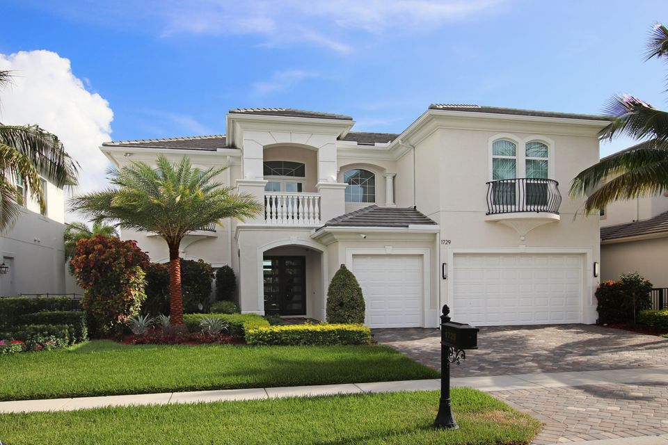 Sleek and clean, contemporary accents throughout this beautiful 4BR/5.5BA home in popular Juno Beach! Interior features include 36 in. porcelain tile & acacia wood floors, decorative, modern wine storage, back-lit onyx wine bar, loft with study desks & game room, upgraded kitchen with Kohler stainless sink, Wolfe gas range, double oven & microwave, Bosch dishwasher, Subzero refrigerator, stainless hood with pot filler, office with built-in desks & more! The outside living area includes a gas range, Kamodo Joe smoker, bar & more. Catch the ocean breezes year round!