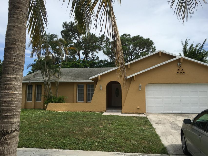 1486 Woodcrest Road N, West Palm Beach, FL 33417