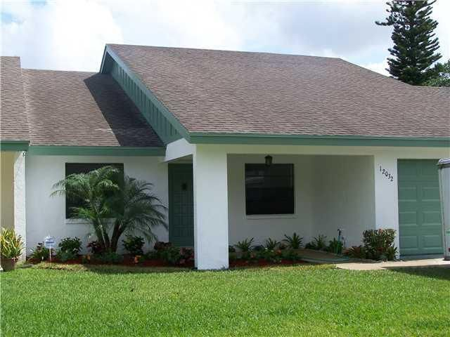 Wonderful opportunity to rent a beautiful 3 bedroom 2 bathroom home in Channing Villas of Wellington. This quiet community is located within minutes of the wellington green mall, the wellington square plaza and the Florida turnpike.Features:Large Master bedroom and bathroom.Separate kitchen and breakfast area with pass through to the dining room.Open plan living area.Combination of wood and tile flooring throughout.Freshly painted.Large single car garage.Screened in porch.Fenced in yard.Lawn and pest control included.Smaller pets are allowed at landlords discretion.