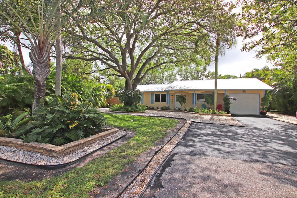 This is the Tequesta home you have been waiting for. Incredibly desirable, cul-de-sac location on Dover Circle. Situated on a very private lot, this 3/2 home also offers a one-car garage, over-sized pool, and large indoor laundry room. 406 Dover Circle has been meticulously updated and maintained by its current owner. Recent upgrades include: 2015 standing seam metal roof, new hurricane impact windows and doors (2014), new duct work (2015), new instant hot water heater (2017), newer air-conditioning and appliances. The eat-in kitchen was totally updated in 2014. The master bath has been recently remodeled (2017) and each bedroom features laminate wood flooring. Arguably the best lot in the neighborhood. Low-traffic street and a lushly landscaped back yard with Southern exposure.