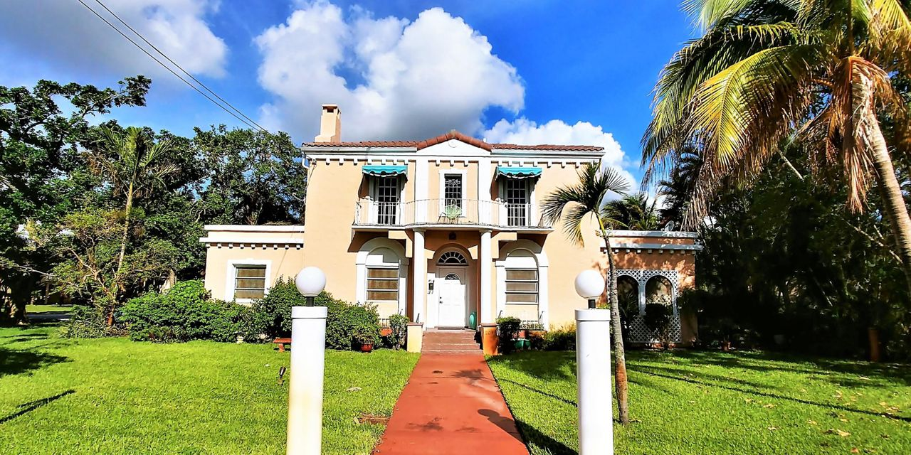 The Mary B Lyman house at 209 S Lake Dr., was built in 1925. This must see gem of Lantana, which sits across from the Intra-Coastal Waterway with water views from the second floor, on a spectacular over sized 16,400 Sq-ft lot. The main house, currently consists of four units including a carriage house, totaling 3,696 Sq-ft. A distinction of this property is the          various potential uses, including rental income or restoring it to its  beauty of a Single Family Home. If you are a preservationist, this is a trophy of Lantana. Property will be sold 'As Is' and considering cash offers only.