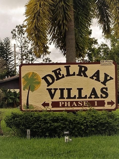 Rare Delray Villas 1 Listing! Single story, Corner Unit, 2 Bedroom, 2 full Bathroom- Waterfront Villa with 2 Private Parking spaces steps from the front door. The home also features two outdoor patios & an enclosed Florida Room with Ceiling Fan and Cable TV; great for winter guests or bright and airy Office space. The A/C unit is like New and the Washer and Dryer is located in the Kitchen Pantry rather than Outdoors. Least expensive Corner unit on the Water side of the street in some time. Come Make it your own, today!