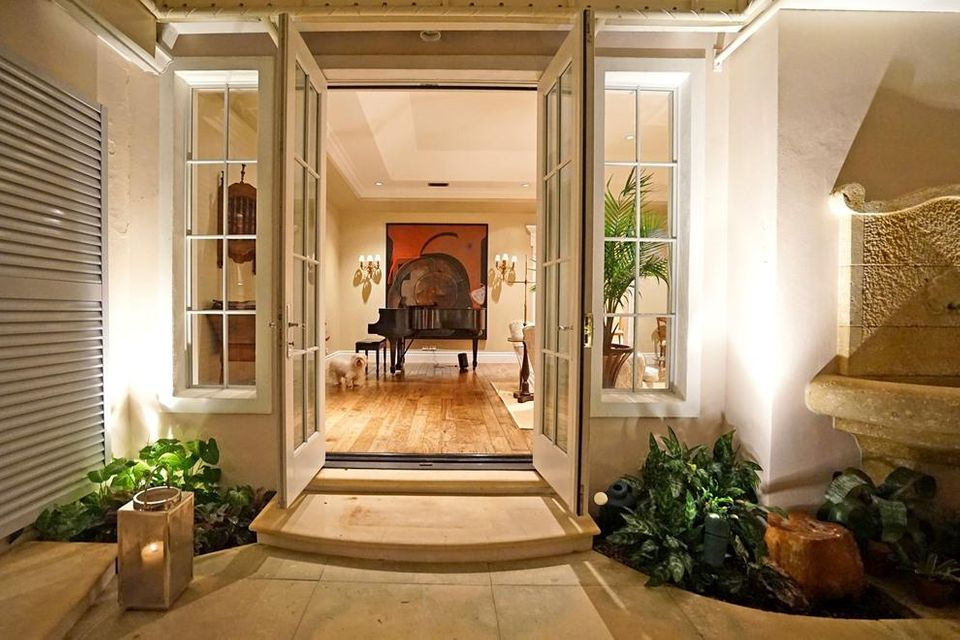 French doors lead to the loggia