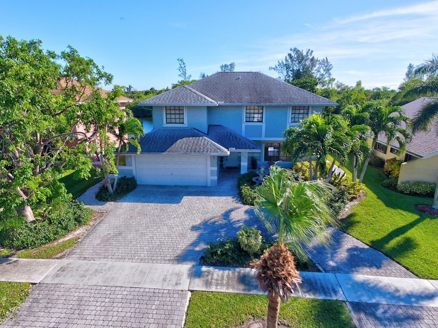 Desirable property at Boca Winds. 4/2.5 home that offers a spectacular water view, dock, private pool, with two car garage. Upgraded Wood and Corian kitchen. Upgraded Bathrooms.   Spacious and bright open concept. Low HOA fee and ''A'' rated schools.  Great opportunity to make your own!