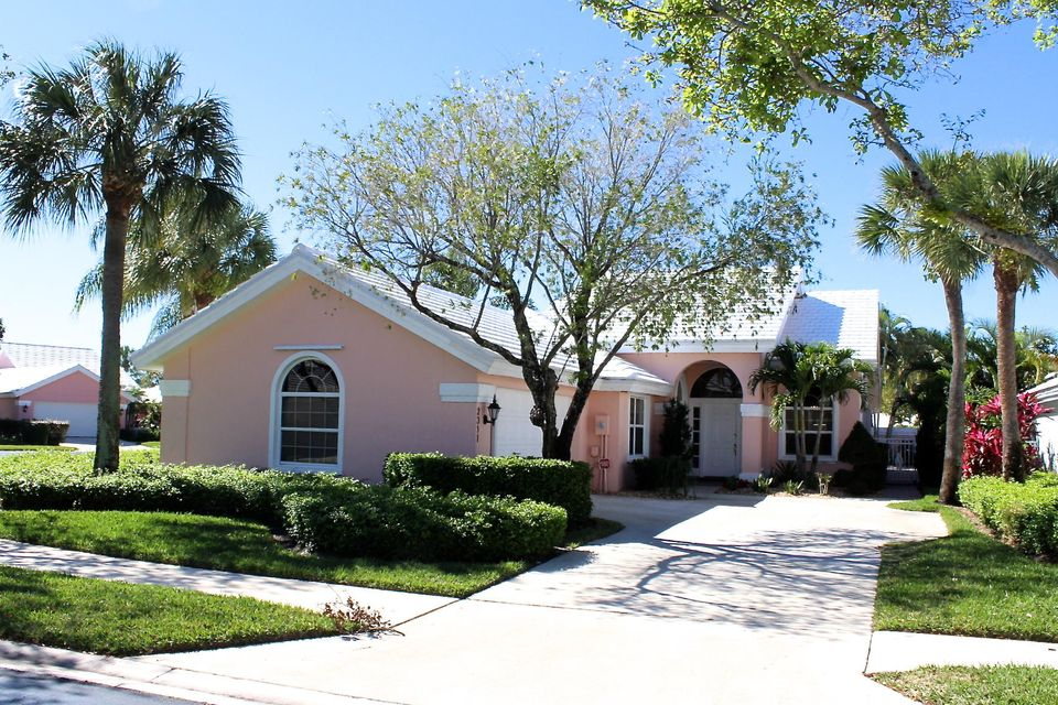 Owner has recently replaced all the sliding glass door with Impact glass sliders. New roof, Beautifully remodeled Divosta home, centrally located in the exclusive gated community of Saratoga Bay, which is surrounded by the prestigious Bear Lakes Country Club. Updated kitchen with brand new SS Samsung appliances. Bathrooms have been completely remodeled with marble floors, custom built in vanities, and frame less showers. Brand new travertine pavers surrounding the back and side patio with beautiful grilling area. Private corner lot that does not back up to another home with a giant amount of green space to the side. Club membership is not required.