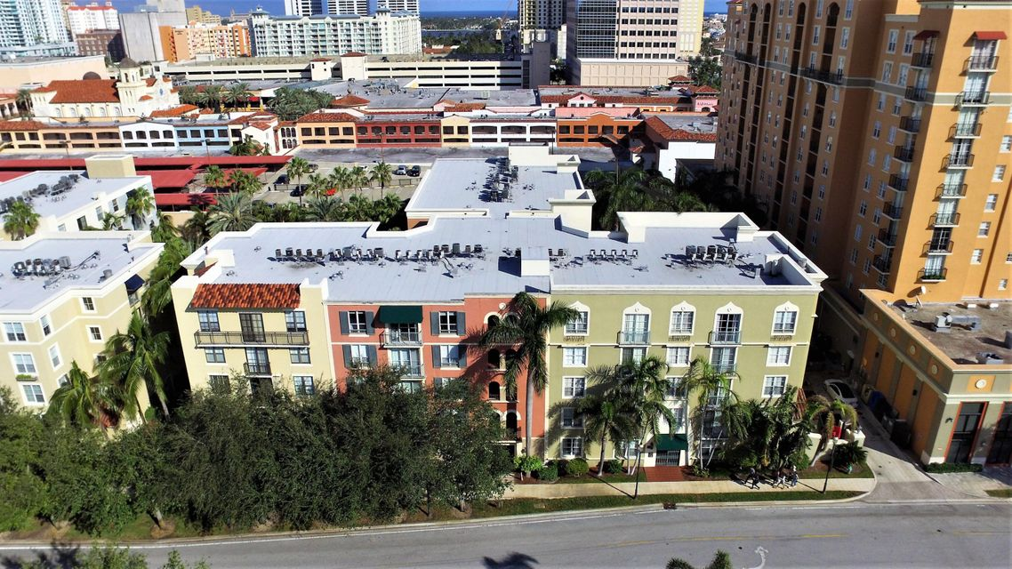 WOW!!! Don't miss your chance to own one of the most fantastic units in the highly desirable Courtyards in Cityplace. This corner unit top floor penthouse comes with 2 PARKING SPOTS!!! The chefs kitchen has been remodeled with custom cabinets featuring lazy susan's and new,modern hardware. Enjoy your extended granite counters and newer GE appliances. AC has been replaced in 2013 and the hot water heater was replaced in 2015. The living area boasts crown molding, 9 foot ceilings, 18'' ceramic tile, and oversized, extended balcony. Bathrooms have been remodeled with custom vanities featuring soft close cabinets, granite counters, and new medicine cabinets. Condo fee includes water, common area maintenance, amenities, and building/roof insurance. Live in the center of all the action. Walk to Cityplace for amazing restaurants and shopping. The trolley pickup is right in front of the building entrance that will take you anywhere downtown WPB for free!!! There is also additional storage available for rent on each floor next to the elevators. The gem will not last.