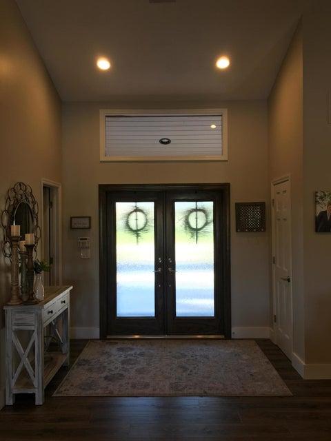 Front entry w/Closet & Powder Room