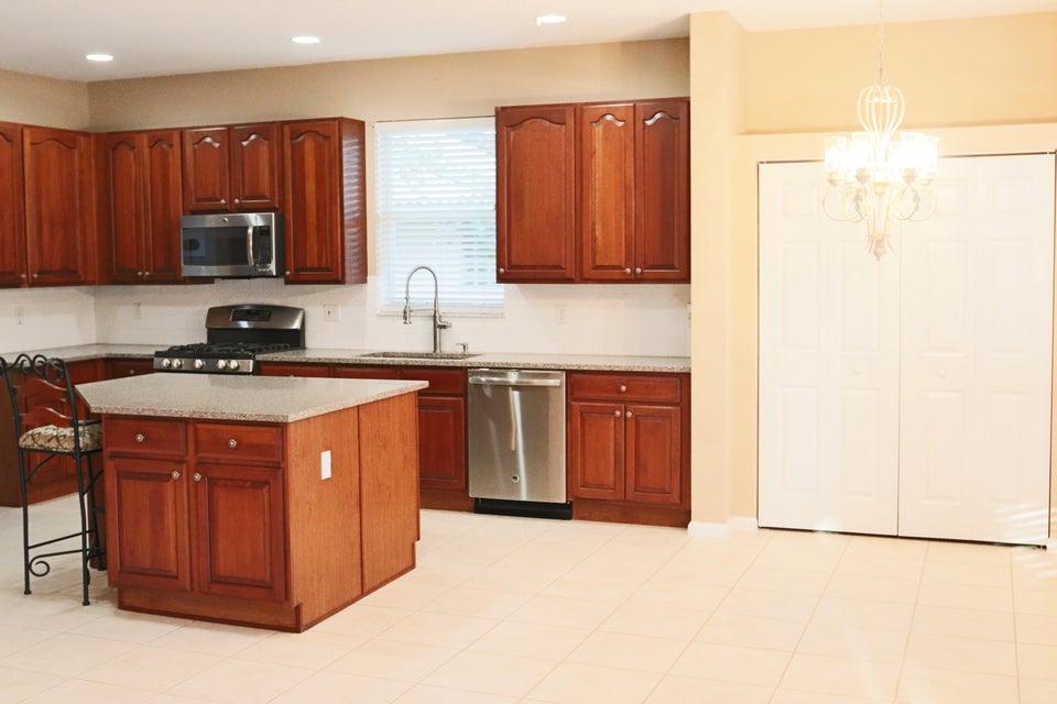 Kitchen view toward pantry