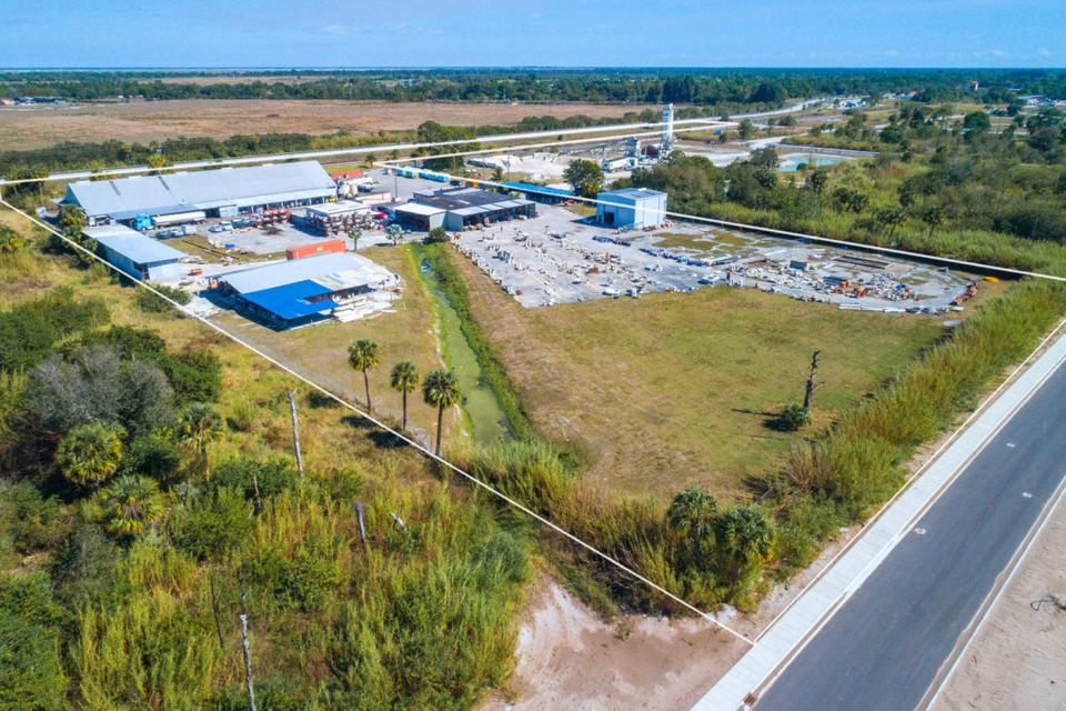 6.47 acres of developed property, great rental potential for manufacturing or industrial. This site has 5 buildings with a totaling of 29000 sq ft of steel frame.3 phase electric, 4'' water line, and an easement for  easy access on both sides of property.  CSX rail service can be re-activated with rails on property ,3 of the out buildings has grade level door access. One of the building already producing a rental income. Don't miss this Great Opportunity to own this industrial land.