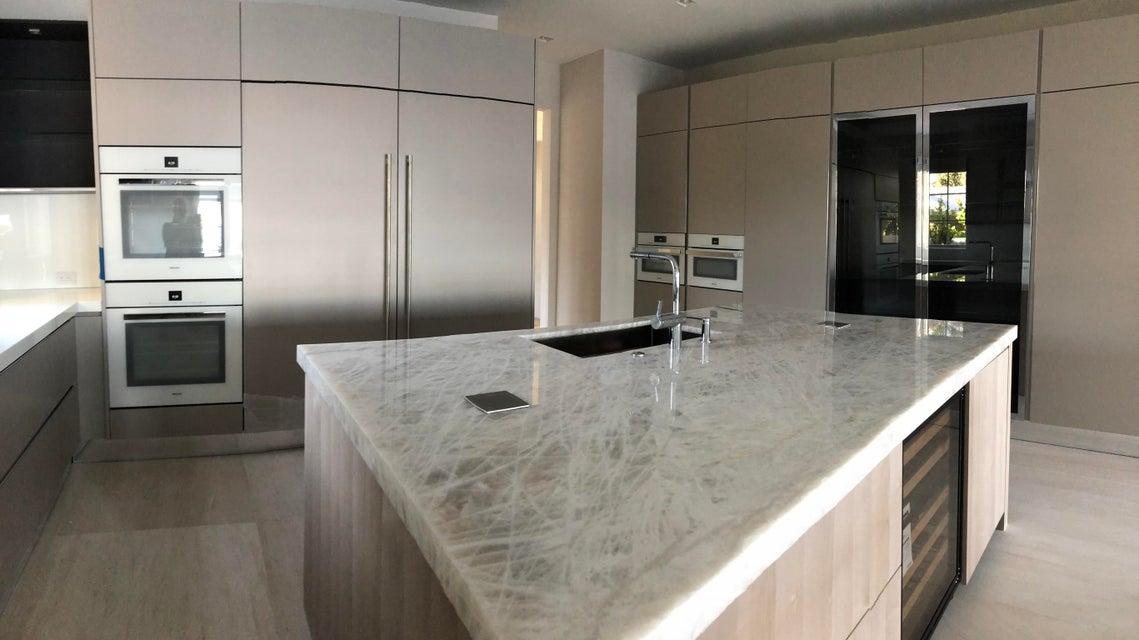 kitchen with onyx slab island