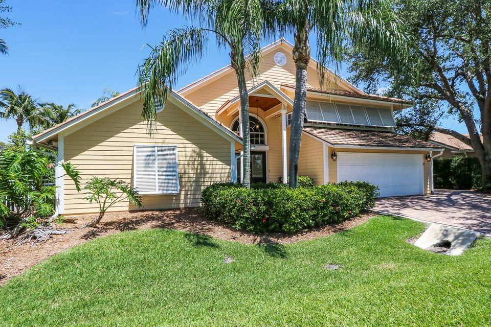 Stunning waterfront, pool home with ocean access. Uniquely nestled between the Loxahatchee waterway and the remarkable Tom Fazio's designed Riverbend Golf course. Enjoy this double lot with over 3,400 square feet of living space, 4 bedrooms, plus office and loft. Pictures cannot fully express the charming architectural angels of this home. Note the exquisite details along your tour, with two wood burning fireplaces located in the living room and master suite, tongue and grove ceilings, crown moldings, plantation shutters, Saturnia, Travertine and wood flooring throughout, you will be overcome with delight. Breathtaking gourmet style, custom kitchen with wood cabinetry, paneled Sub Zero refrigerator, Thermador induction cook-top and DCS confection micro and oven with warming drawer. Over-sized kitchen island with top of the line, single seam, granite counter-tops and wine refrigerator. Expansive kitchen and breakfast nook opens to a cozy family room with angled tongue and grove wood ceilings. Three downstairs bedrooms, one on-suite and the other two share a Jack and Jill bath. Private upstairs master suite with large upstairs outdoor deck to enjoy water and sunset views. Upstairs office offers spectacular golf course views. Indulge in the outdoors with a large resurfaced Diamond Brite pool, Seminole built Tiki Hut and waterfront views. This home is equipped with all the essentials of a tropical paradise from the lush landscaping to the maintenance free Trex composite decking that lead you down the 40' dock to a 12,000 lb. boat lift.  Bring your boat and start your journey to either the turquoise Atlantic Ocean waterways of Jupiter or an adventurous voyage through Jonathan's Dickinson State Park off the Loxahatchee River.    North Passage is a desirable Community bordering state park with abundance of wild life, gym, club house, community pool, and tennis courts, 24 hour guard gate with low HOA fees. Option Golf memberships available. North Passage Yacht Club offers m