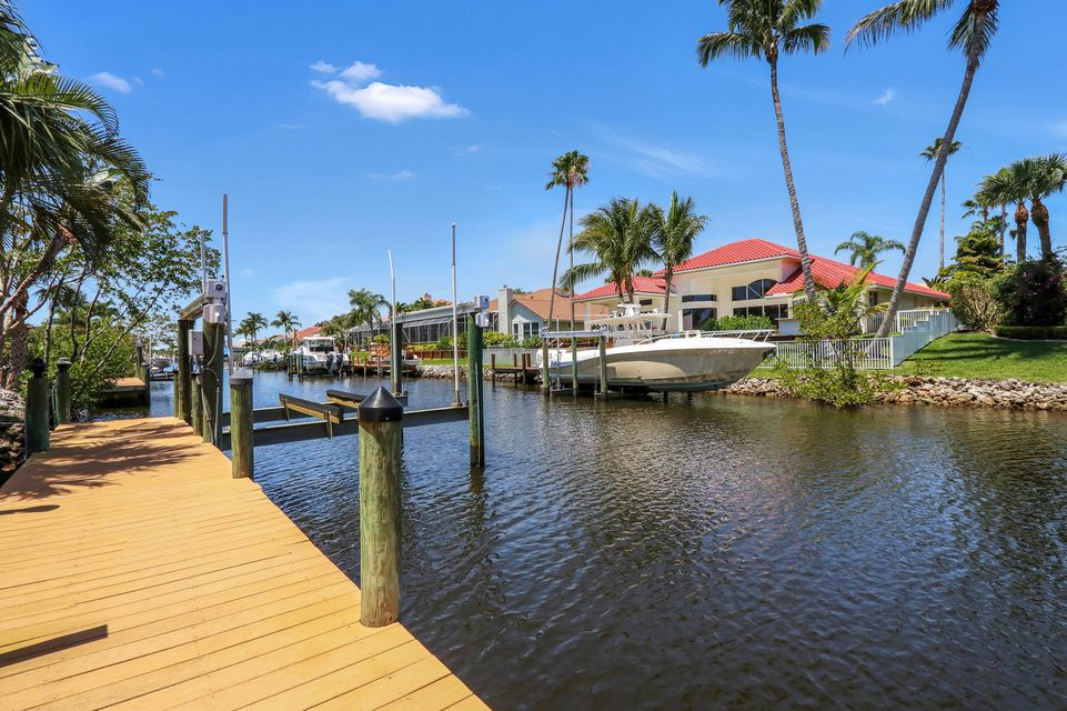 Stunning waterfront lot, uniquely nestled between both of the Loxahatchee waterway and the remarkable Tom Fazio's designed Riverbend Golf course. This is the only buildable lot left in North Passage.Bring your boat and start your journey to either the turquoise Atlantic Ocean waterways of Jupiter or an adventurous voyage through Jonathan's Dickinson State Park off the Loxahatchee River.  Adjacent, included, fenced lot is a Tropical oasis of its own with Mango, Avocado, Banana, Navel Orange, Tangerine, Star Fruit, Royal Poinciana, Jacaranda, Bird of Paradise, and Royal, Coconut, Queen, and Sable Palms. North Passage is a desirable Community bordering state park with abundance of wild life, gym, club house, community pool, and tennis courts, 24 hour guard gate with low HOA fees. Option Golf memberships available. North Passage Yacht Club offers monthly meetings, raft up dinners on the river, and group trips to the Bahamas. Centrally located and only 30 minutes to Palm Beach International. Owner will not sell the lot before the home is sold.