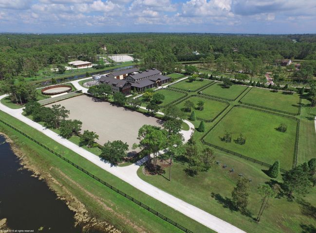 Aerial view of the Equestrian Facilites. Paddocks, round pen, hot walker, arena, stables and grooms housing.