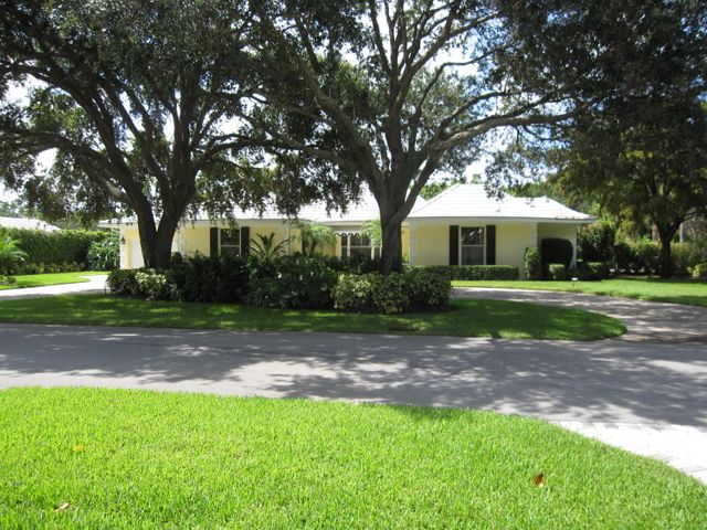 Graced with stately oaks and situated on .46 of an acre, this is a delightful home located in the private enclave of the Village of Golf.
