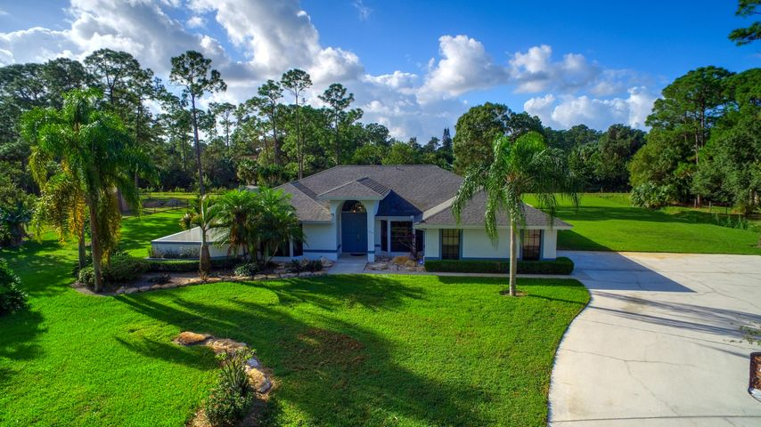 12730 175TH Road N Jupiter, FL 33478 is 4 bedroom home located on 1.5 acres in Jupiter Farms.
