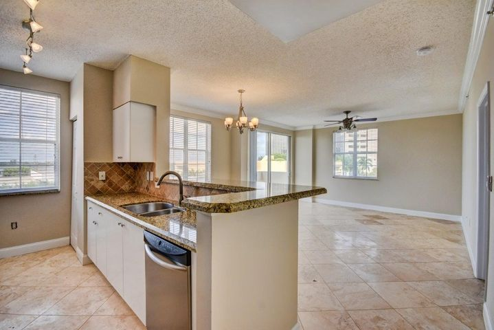 Upgraded granite counters, appliances, custom backsplash and deep stainless sink. Huge breakfast bar!