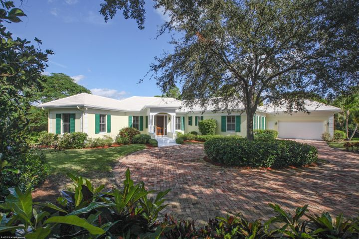 Elegantly elevated on over 1.64 acres of beautiful golf course views and pond vistas this custom home has over 4100 SF of living space.