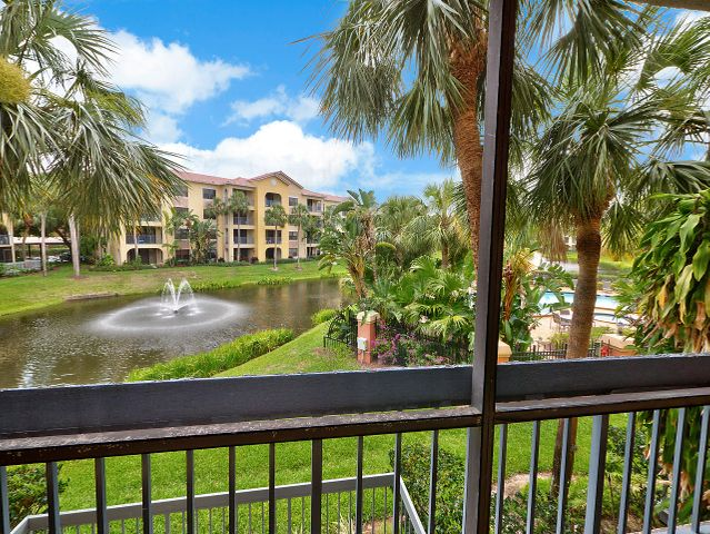 Lovely view from the patio, overlooks community lake and pool area. This is actual photo from the unit patio.